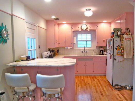 My pink dream kitchen...the only thing I would change would be the fridge countertops and floor...oh, and the wall clock. Maybe it isn't my dream kitchen after all...