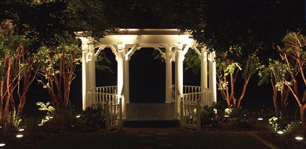 Professional landscape lighting can create evening vignettes of beauty in your landscape.