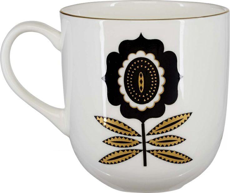 Klaus kopp m/blomst i porselen. Kr. 90,-