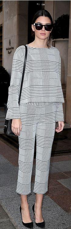 Kendall Jenner: Shirt and pants – 10 Crosby Derek Lam  Shoes – Manolo Blahnik  Purse – Celine