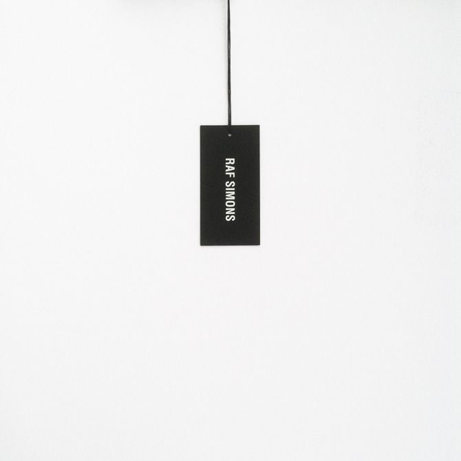 Swing Tag for Raf Simons. Online Presence and Brand Identity by Francisco Salvado Creative.