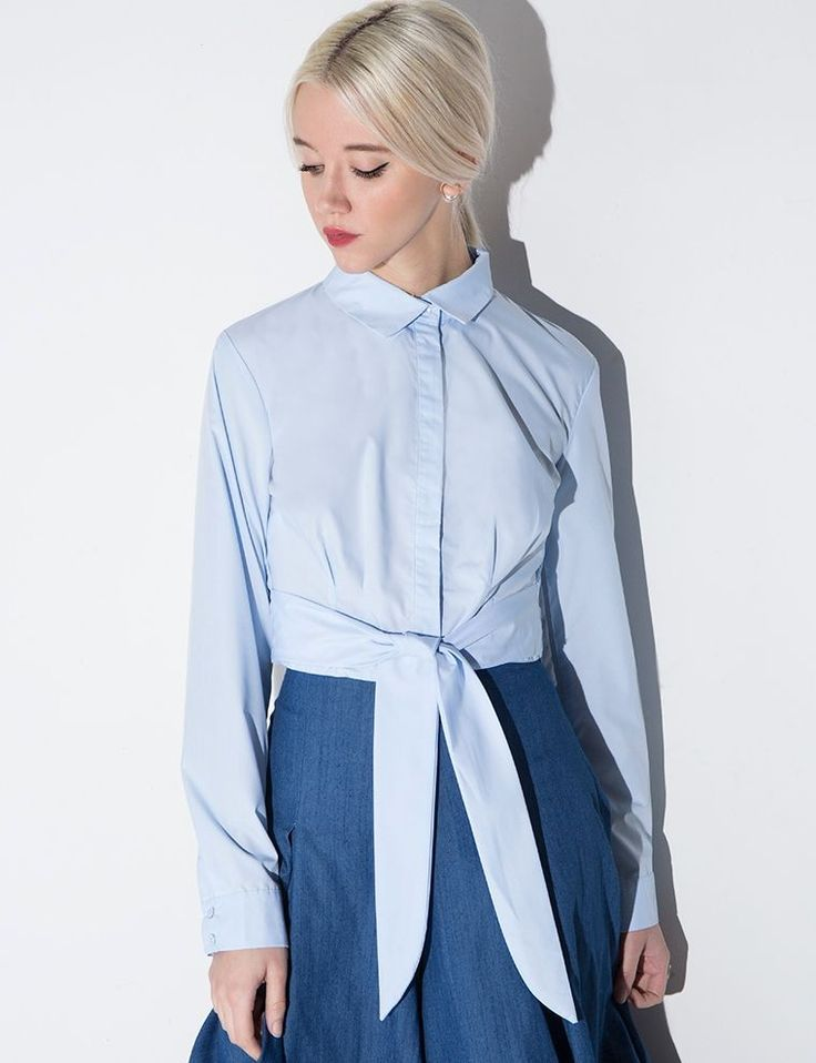 The Under-$50 Work Trend Every Fashion Editor Is Buying #refinery29  http://www.refinery29.com/affordable-button-up-shirt-trend#slide-3  Just think of how good this would look with some high-waisted trousers.Pixie Market Light Blue Waist Tie Crop Shirt, $43, available at Pixie Market....