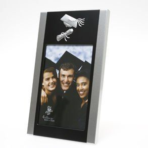"""Two Tone Graduation Picture Frame by Century Novelty. $9.95. Save Memorable Moments with a Graduation Picture Frame! A graduation picture frame is a great addition to your graduation celebration. Display the graduate's senior pictures on your party tables, plus the picture frame makes a great keepsake for the graduate. 8 1/2"""" long and 5"""" wide frame. 4"""" x 6"""" picture holder. Silver and black metal frame. A graduation picture frame makes a great gift for the grad, as well a..."""