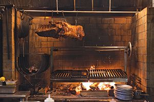 The Grillworks grill at Reynard in action. ADJUSTABLE wood fired grill ~ a dream come true!