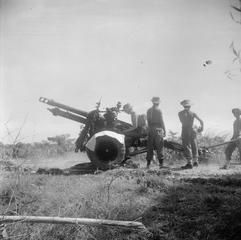 THE BRITISH OCCUPATION OF JAVA. A 25 pounder field gun of the Berkshire Yeomanry prepares to open fire near Surabaya (Soerabaja). Here the Berkshires provided artillery support to Indian infantry holding the perimeter line around the town.