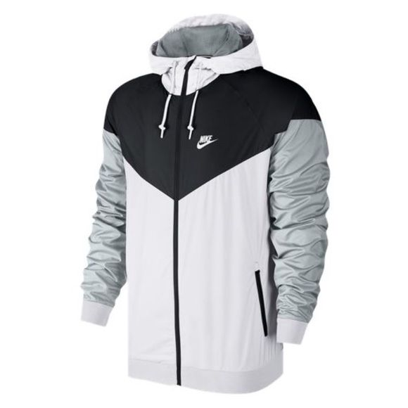 Nike Windrunner Jacket. PRICE FIRM! I DON'T TRADE! The Nike Windrunner legacy continues with the Nike Windrunner Men's Jacket, returning with a fresh color-blocked look. Lightweight ripstop fabric provides durability. Paneled hood with a bill and drawcords offer warmth and coverage. Chevron design gives the classic Windrunner with a bright pop of color. Vent on the back yoke enhances breathability. Zippered pockets pop in a contrast color and provide convenient storage. 100% polyester. ‼️…