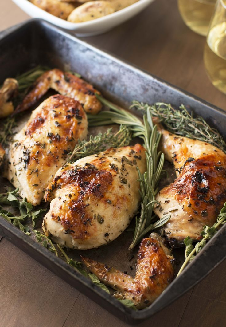 Roasted chicken with white wine and fresh herbs is the perfect quick weeknight…
