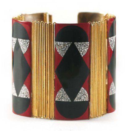 Jean DUNAND (1877 - 1942) Bracelet articulé en métal doré alterné de cinq pl