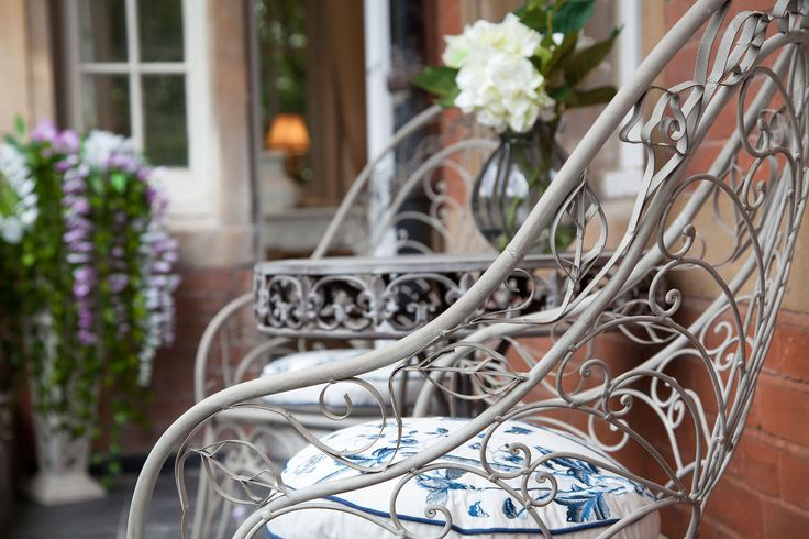 Exterior close up of Wrought Iron Chair on balcony overlooking Hyde Park | JHR Interiors