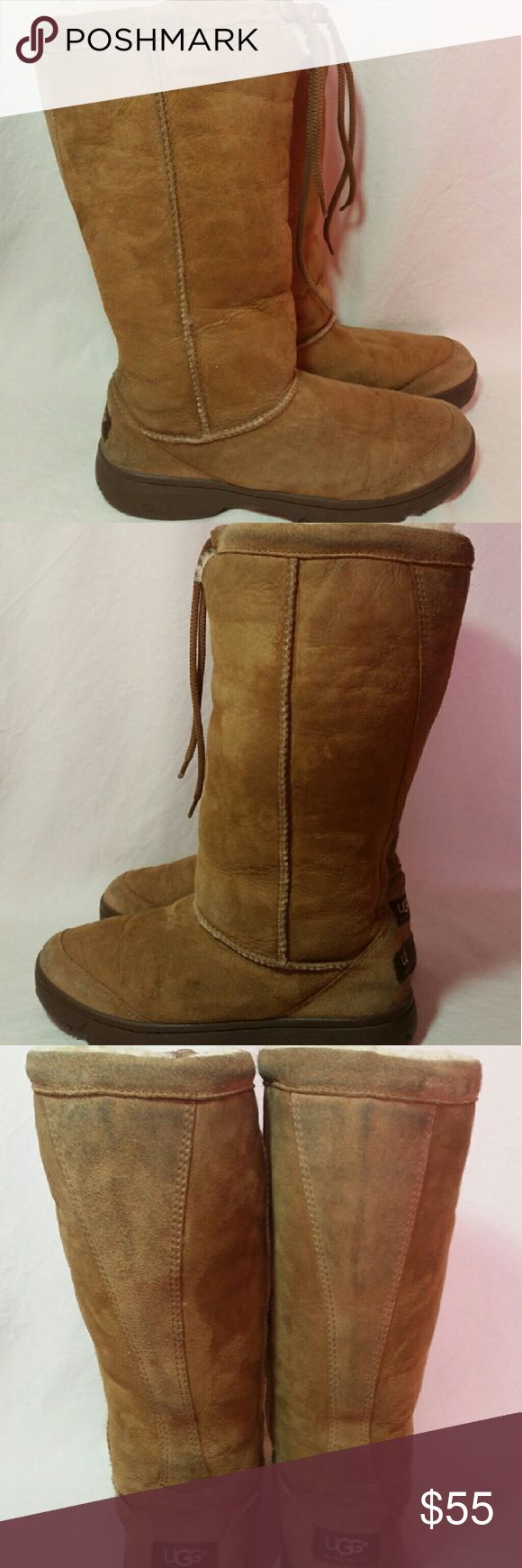 Womens UGG Ultimate Tall Sheepskin Boots Size 8 This pair of women's UGGS is simply awesome. They haven't been worn very much shown on the soles, but they have some marks around the top and back side, nothing horrible (shown in photos) This pair of UGGs Ultimate Tall Boot is made from grade A sheepskin and suede. Size 8 UGG Shoes Winter & Rain Boots