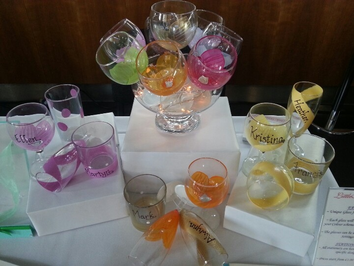 Unusual wedding favours.........hand painted  glasses acting as name place cards.