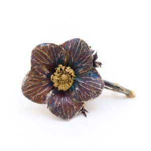 Sifis Jewellery - A real Anemone flower crafted from Oxidised Silver and Gold. Each part of the flower is separately treated. The petals of the flower are in oxidised Silver with unique colouration, while the stamen is completely crafted out of gold.  A unique piece that can be worn as a brooch or placed as a decorating object.