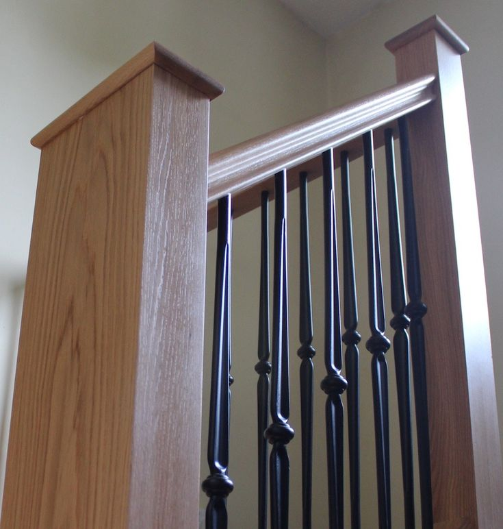 Traditional Staircase With Wrought Iron Metal Stair Spindles.