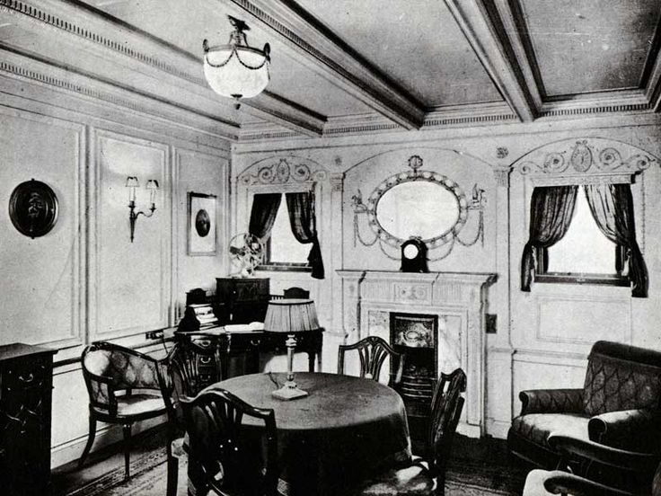 The sitting room of a first-class parlor suite on Olympic and Titanic is decorated in the Adam style. The mantelpiece enclosed an electric heater.