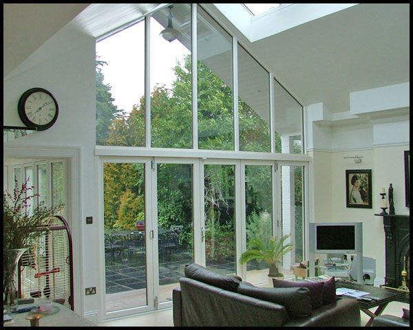 how windows on back of bungalow would look on a gabled extension of kitchen. 2 story though, bottom doors in kitchen, top gabled window in loft conversion baedroom