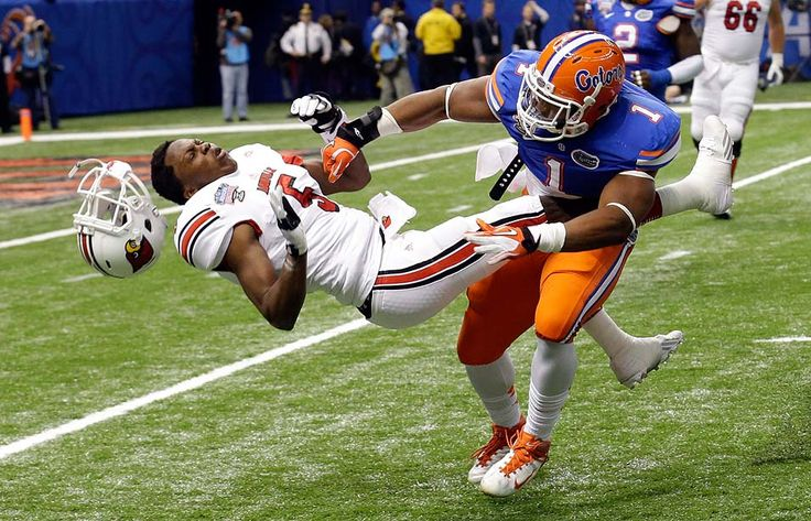 New Orleans — Florida linebacker Jon Bostic (1) hits Louisville quarterback Teddy Bridgewater (5) hard enough to dislodge his helmet in the first quarter of the Sugar Bowl NCAA college football game Wednesday.