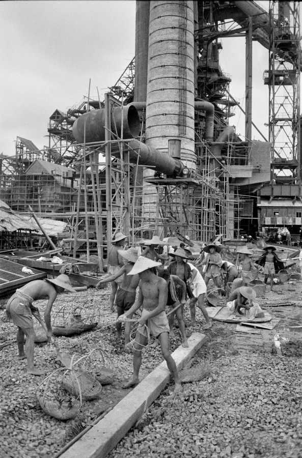 Workers enlarging a steel mill in Wuhan
