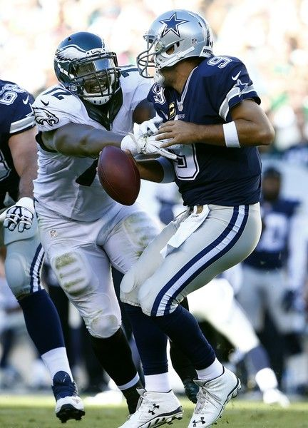 Tony Romo Photos Photos - Quarterback Tony Romo #9 of the Dallas Cowboys is sacked by Cedric Thornton #72 of the Philadelphia Eagles during the second quarter of a football game at Lincoln Financial Field on September 20, 2015 in Philadelphia, Pennsylvania. - Dallas Cowboys v Philadelphia Eagles