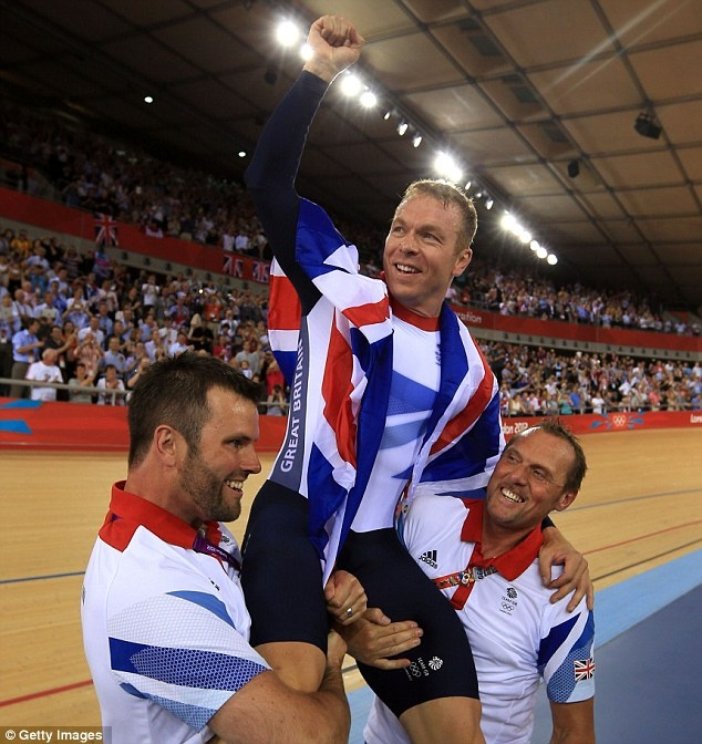On top of the world: Sir Chris Hoy is lifted by fellow members of Team GB's cycling team after winning his sixth Olympic gold medal