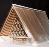 A collection of buildings incorporating engineered cardboard waste