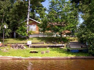 Year around cottage or home 68ft on Wasi lake near Powassan, just north of Muskoka. (MD7649957) -  #House for Sale in Powassan, Ontario, Canada - #Powassan, #Ontario, #Canada. More Properties on www.mondinion.com.