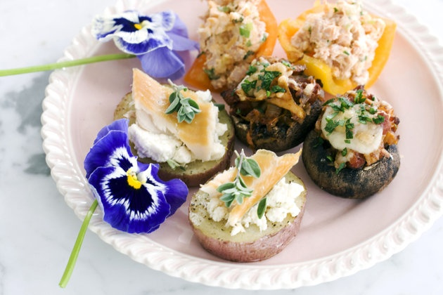 In this image taken on April 22, 2013, smoked schmeared potatoes, chorizo hash stuffed mushroom caps, middle, and stuffed baby bell peppers, rear, are shown served on a plate in Concord, N.H. (AP Photo/Matthew Mead)