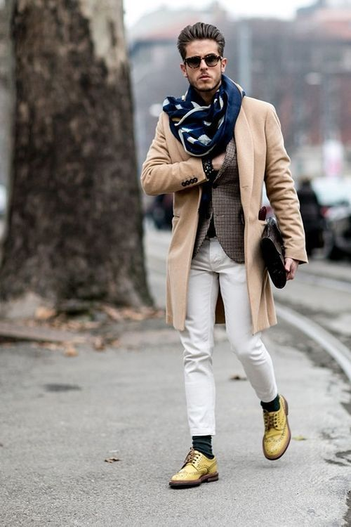 Hipster with skinny jeans, blazer, coat, scarf and yellow shoe, sunglasses.