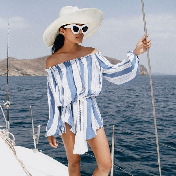 Olivia Lopez from the blog Lust for Life wearing a gorgeous blue-white striped yacht outfit