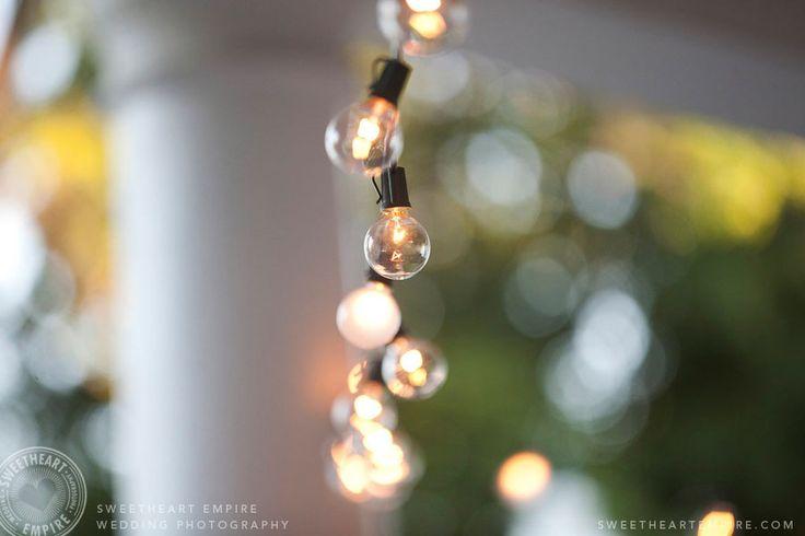 Fairy lights wrapped around a pillar at Geraldos at LaSalle Park in Burlington. Wedding Photography #sweetheartempirephotography