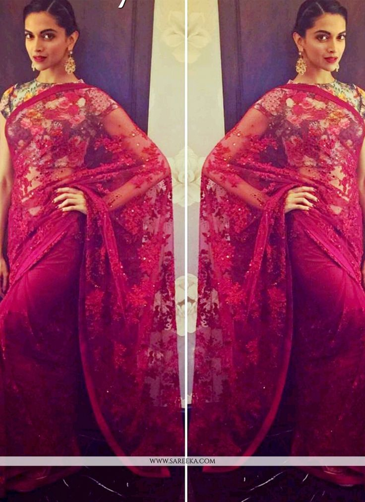 Women beauty is magnified tenfold in this Deepika Padukone maroon net bollywood saree. This beautiful attire is showing some amazing embroidery done with patch border and sequins work. Comes with matc...