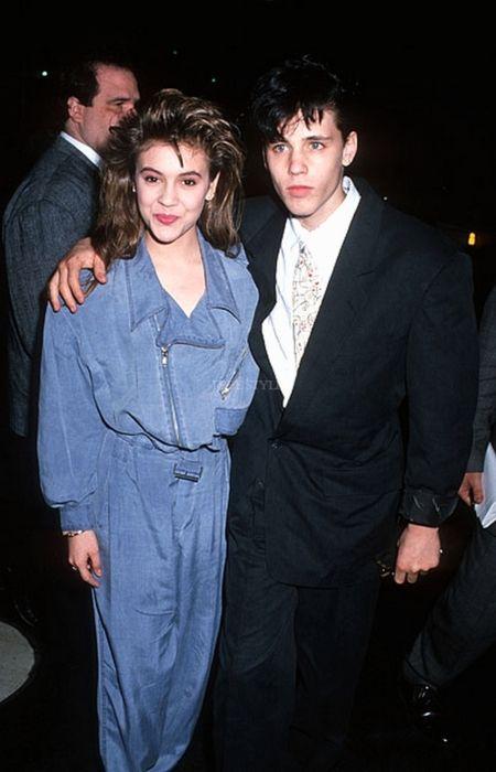 Alyssa Milano in a jean jumper and Corey Haim. 80s fashion.