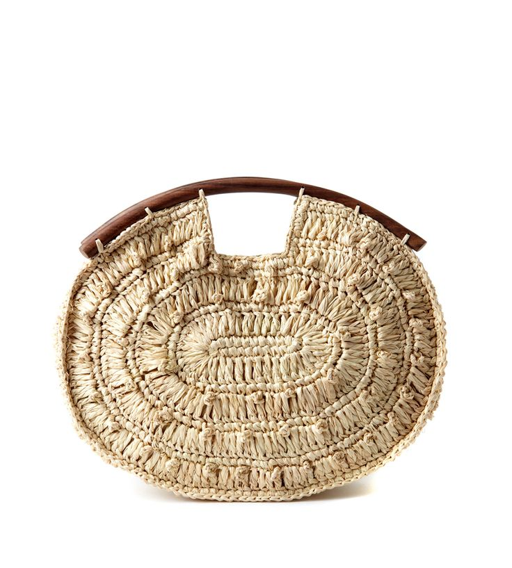 """The Juliette Clutch from Mar Y Sol's """"The Girls"""" Collection has a vintage vibe. Inspired by the gypset of the 1970s, this clutch is adorned with hand carved wood handles sustainably sourced from the forests of Madagascar. 100% Crocheted raffia with cotton lining and snap closure. 10""""h x 12""""w x 2.5""""d **USE CODE ROMXCOREY30 FOR 30% OFF!"""