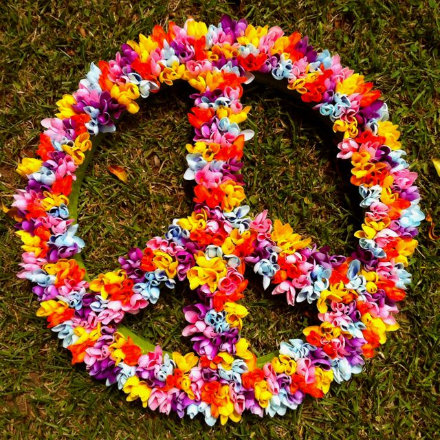 Peace & love sign I did for mu daughter's party with plastic flowers... They look pretty real huh?
