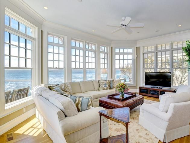 wall of windows large windows windows and doors casual living rooms cozy living living spaces closet rooms minimalist living rooms ocean city md