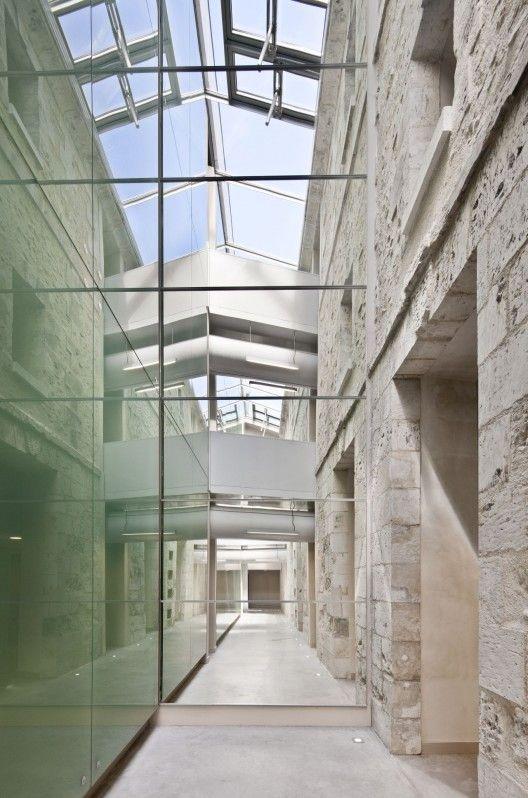 Architects: Opus 5 Architectes Location: Rue Des Pénitents, Louviers, France Architect In Charge: Bruno Decaris, Agnès Pontremoli, Pierre Tisserand Area: 2,000 sqm Year: 2012 Photographs: Luc Boegly, Bruno Decaris