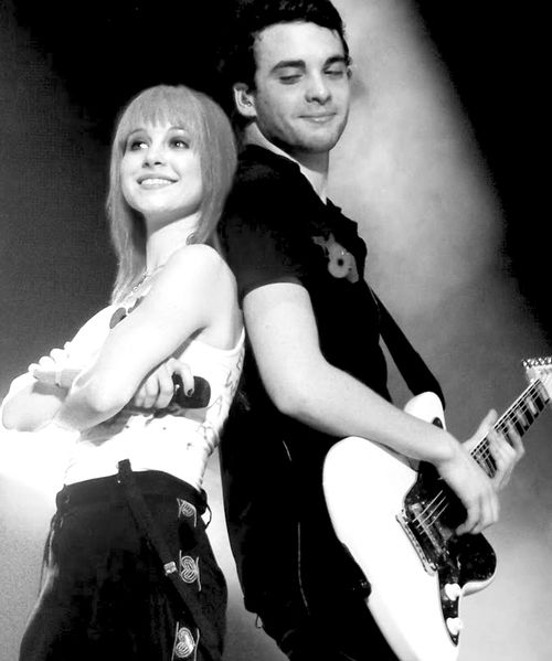 They look like close friends or siblings. Hayley Williams and Taylor York