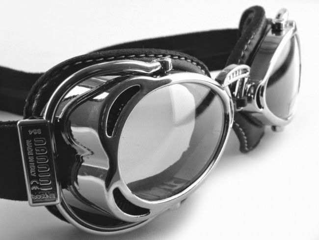 Nannini | Motorcycle Goggles Nannini Motorcycle Goggles with a chrome frame and black leather head strape. Nannini Motorcycle Goggles which is compact and stylish. This Italian made motorcycle goggles has a unique design. The headband is friction proofed. Nannini Motorcycle Goggles is a ideal choice for wearing over open face helmets.