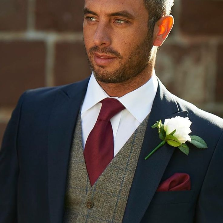 Navy suit with tweed waistcoat from Brides-gallery.co.uk