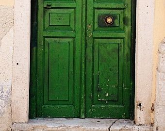 Deep green double doors.