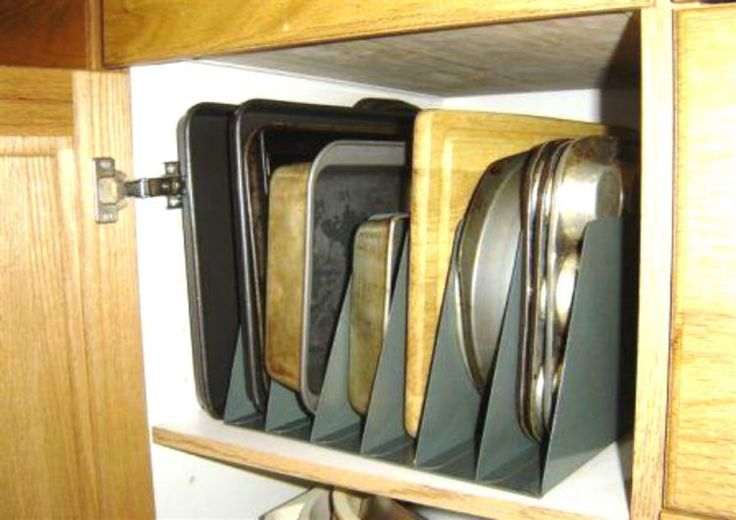 Store baking sheets and cutting boards in metal file holders.