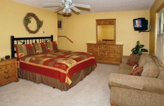 Bearly Workin' is one of the best 2 BR/2 BA Gatlinburg cabins available. This beautiful cabin is complimented with 2 king master bedroom suites, each with large whirlpool tubs. Tastefully decorated and lots of wood provides a cozy living area with a corner stone gas fireplace, sleeper sofa and fully equipped kitchen. There is Charter TV in each bedroom and living room including a Hot Tub on the back deck.