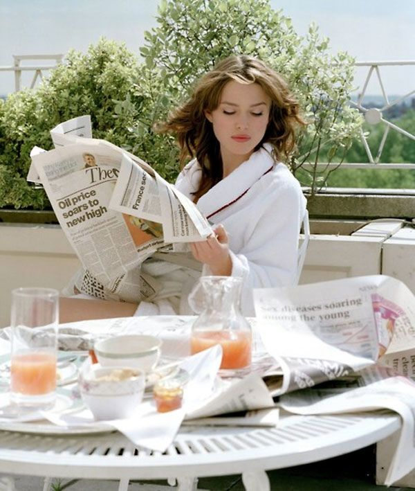 i need more than a few relaxed breakfasts like this... reading the newspaper, drinking grapefruit juice, outside on the terrace, in a robe, with coral lipstick.  yes please.