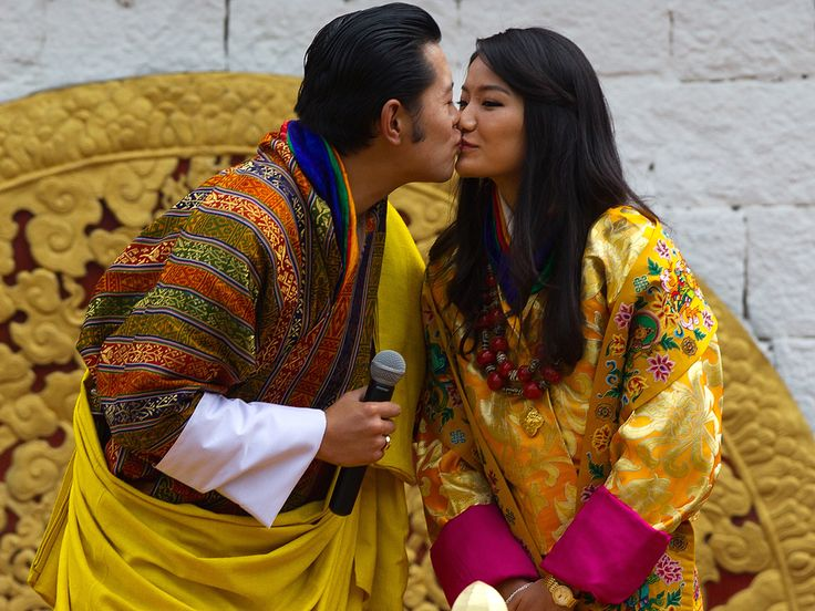 Bhutan's royal couple, King Jigme Khesar Namgyel Wangchuck and Queen Jetsun Pema Wangchuck, kiss in front of thousands of fellow citizens at the celebration ground at ChangLeme Thang in Thimphu, Bhutan.