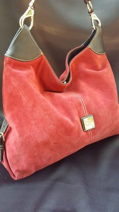 Dooney  Bourke purse with red suede and black leather trim Decorative buckled straps on the ends Silver hardware and center logo Lining is in great shape Gently loved and in great condition with only Clothing, Shoes & Jewelry : Women : handbags and purses for women http://amzn.to/2j9CmhZ