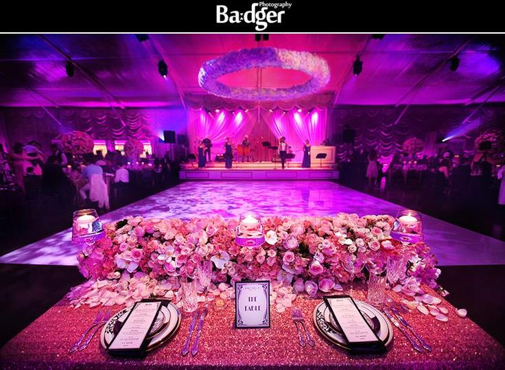 Honor table with stunning flowers and a huge flower fixture over the dance floor. Everything is screaming luxury at this Montreal wedding at 40 Westt restaurant in the west island, by Badger Photography - http://badgerphotography.ca