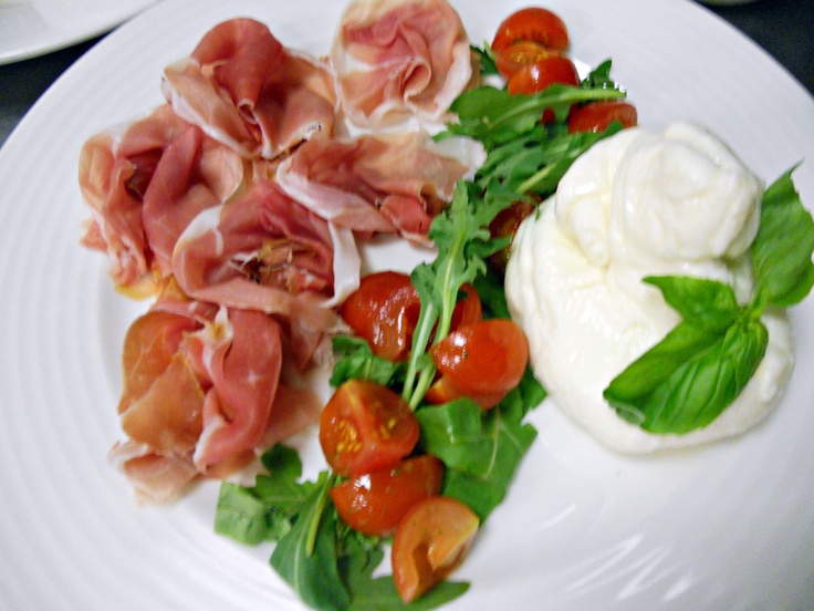 Burrata cheese with cherry tomatoes and San Daniele prosciutto
