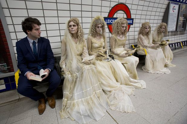 Miss Havishams take to the London Underground to promote a special screening of Great Expectations