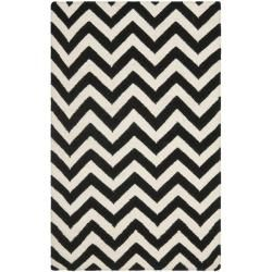 @Overstock - This handmade dhurrie rug features a Moroccan inspired design and dense hand-woven wool pile highlight. This floor rug has a black background and displays stunning panel colors of ivory.http://www.overstock.com/Home-Garden/Chevron-Dhurrie-Black-Ivory-Wool-Rug-3-x-5/6830700/product.html?CID=214117 $65.99