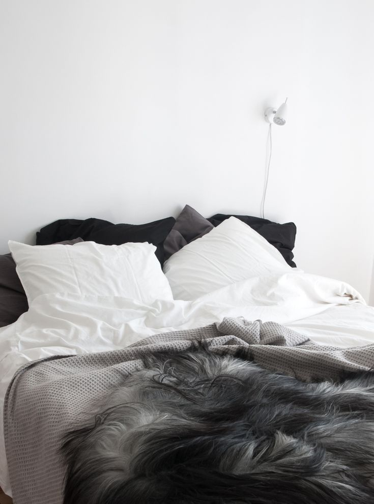 Natural grey Icelandic sheepskin in monochrome Nordic bedroom. 17 best ideas about Nordic Bedroom on Pinterest   Rustic grey