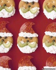 Ritz Cracker Santas - celery, pepperoni, cream cheese and ritz crackers. I used eatable black gel for eyes and nose.
